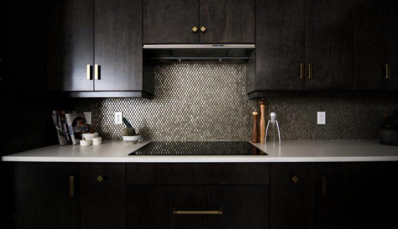 Välj en spishäll med inbyggd fläkt till ert nya kök